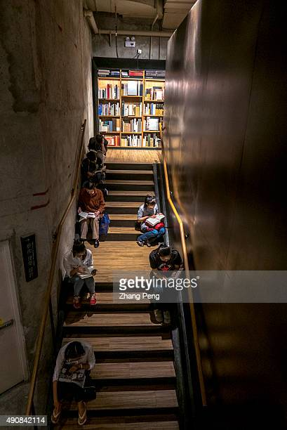 Young people sit on steps reading books in Fangsuo Book Store an independent book store opened in 2015 at the underground level of the Tai Koo Li...