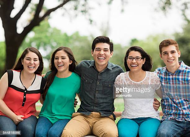 Young people sitting side by side and embracing