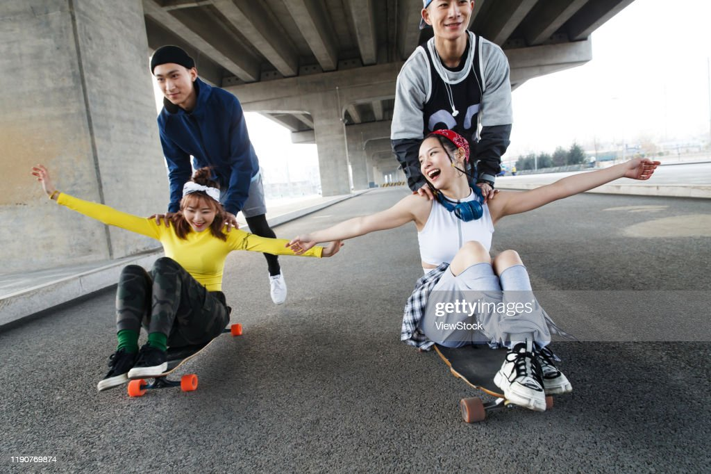 Young people skateboarding : Stock Photo