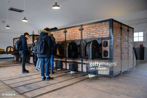 Young people stand in the former crematorium at the Buchenwald concentration camp on January 26 2018 near Weimar Germany International Holocaust...