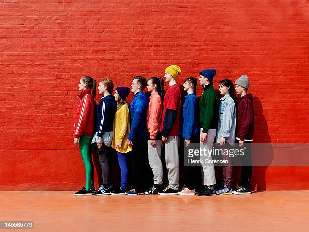 young people standing against each other - lining up stock pictures, royalty-free photos & images