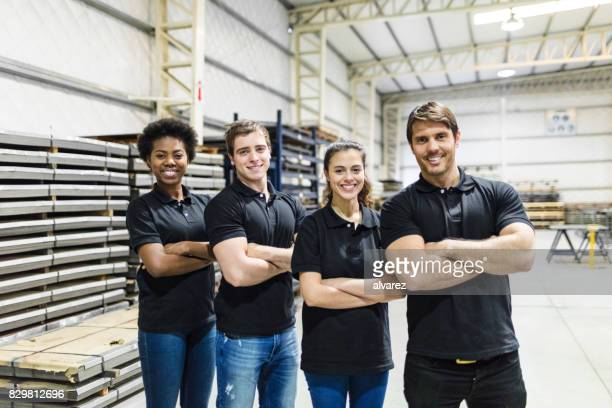 Young people standing together in factory