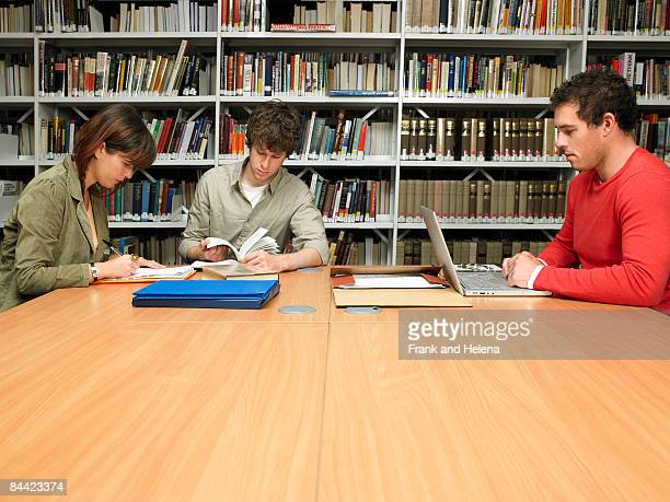 young people studying in library - spelling stock pictures, royalty-free photos & images
