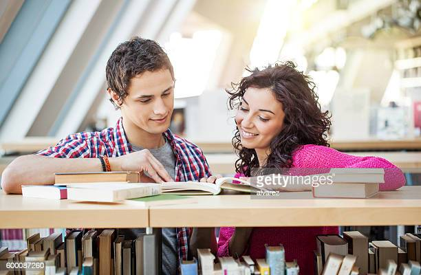 Young people studying together at library
