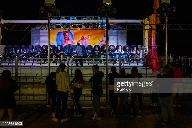 Young people take a ride at the carousel of the Luna Park in Molfetta at Secca dei Pali on 3 October 2020 First day of opening of the Luna Park in...