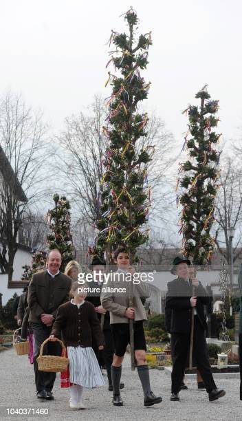 Young people take part in a Palm Sunday procession in Rottach-Egern, southern Germany, 24 March 2013. Palm processions, at the beginning of Holy...
