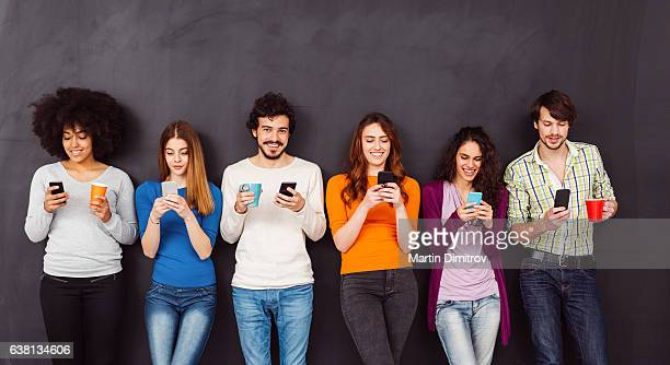 young people text messaging - medium group of people stock pictures, royalty-free photos & images