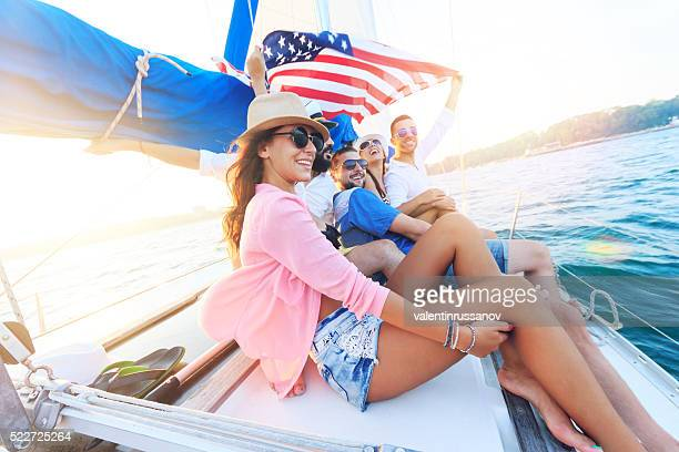 young people traveling with an yacht - american flag ocean stock pictures, royalty-free photos & images