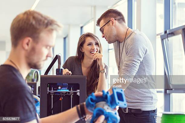 Young people using 3D printer