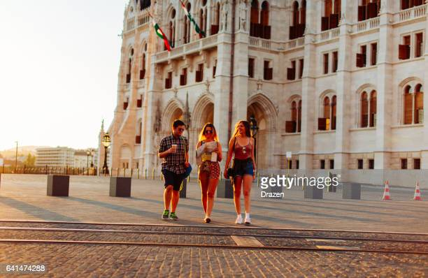 Young people visiting landmarks in European city