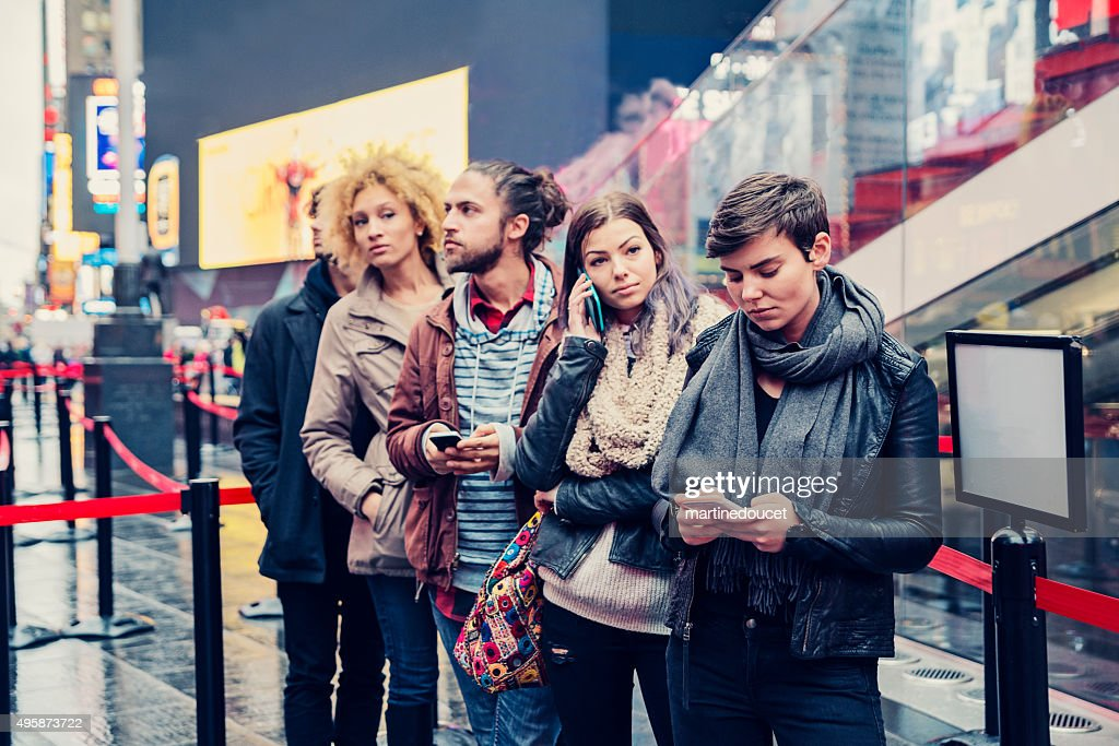 Young people waiting in line to buy tickets in NewYork. : Stock Photo
