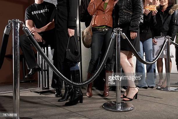 Young People Waiting Outside Nightclub