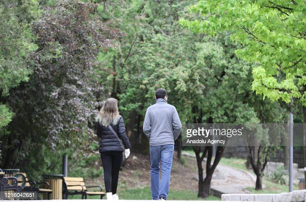 Young people walk at a park after youths between 15-20 years across Turkey allowed to leave their homes, remaining within walking distance and...