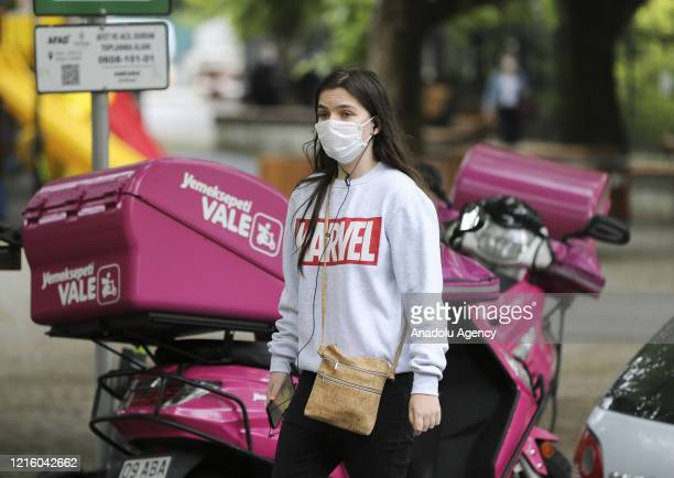 Young people walk at street after youths between 15-20 years across Turkey allowed to leave their homes, remaining within walking distance and...
