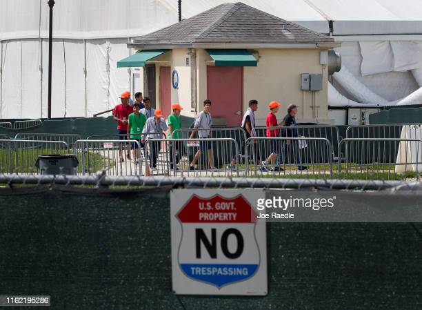 Young people walk the grounds of the Homestead Temporary Shelter for Unaccompanied Children as congress members including Rep Rosa DeLauro Chair of...