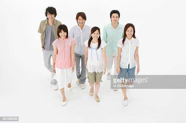 Young people walking, high angle view, studio shot