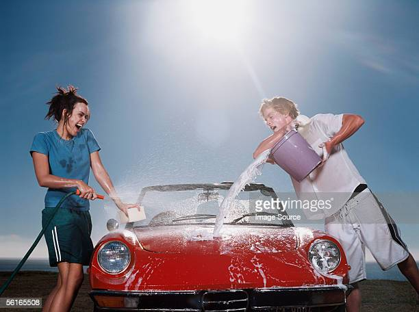 young people washing car - couples showering stock pictures, royalty-free photos & images