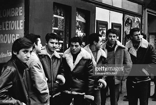Young people wearing leather jackets in front of a cinema on the boulevard de Rochechouart in November 1961 in Paris France