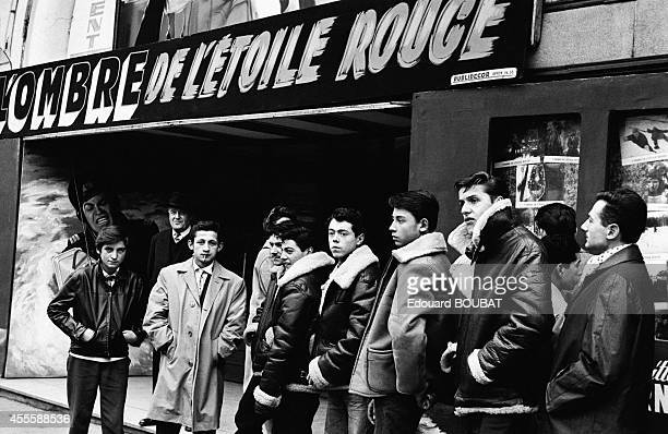 Young people wearing leather jackets on the boulevard de Rochechouart in November 1961 in Paris France