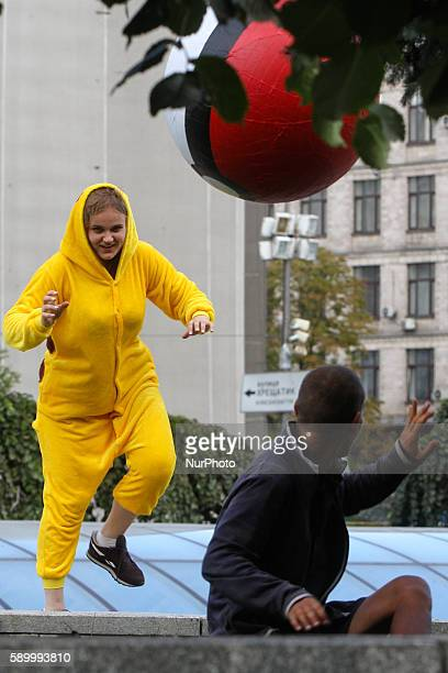 Young people wearing Pokemon costumes hunt the passersby exactly the way people hunt Pokemons playing the quotPokemon Goquot game with their...