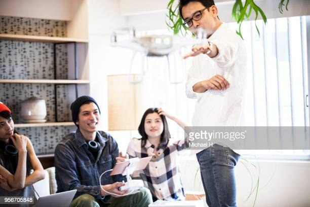 Young people who fly drone in their room.