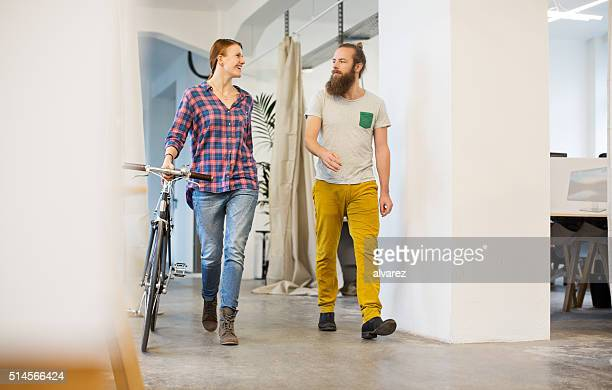 young people with a bicycle at startup - arrival stock pictures, royalty-free photos & images