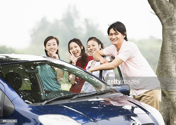 Young people with a car