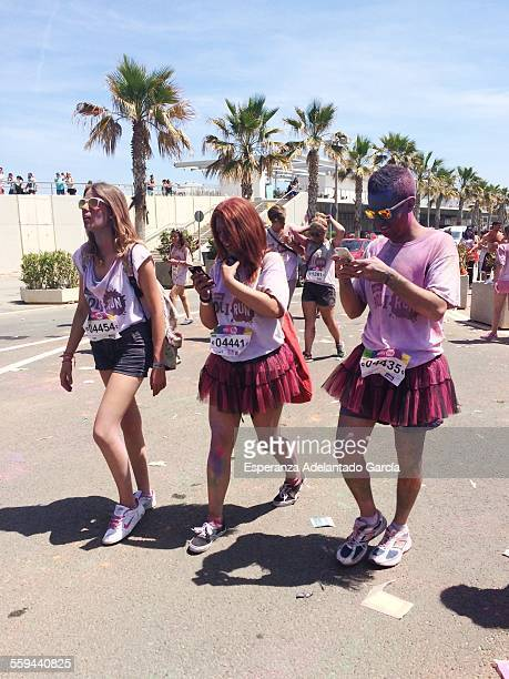 Young people with a smartphone on the street after holi run in Valencia Spain May 10 2015