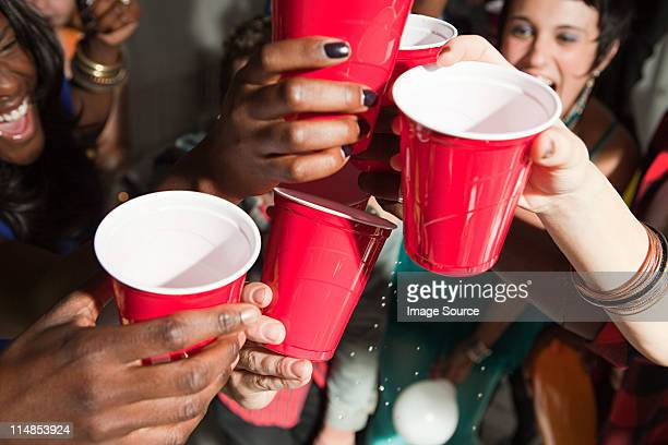 young people with plastic cups at party - disposable cup stock pictures, royalty-free photos & images