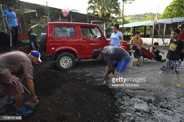 Young people work in the elaboration of a vegetable garden in the community of Dimas Rodriguez, in El Paisnal, 40 km north of San Salvador, on August...