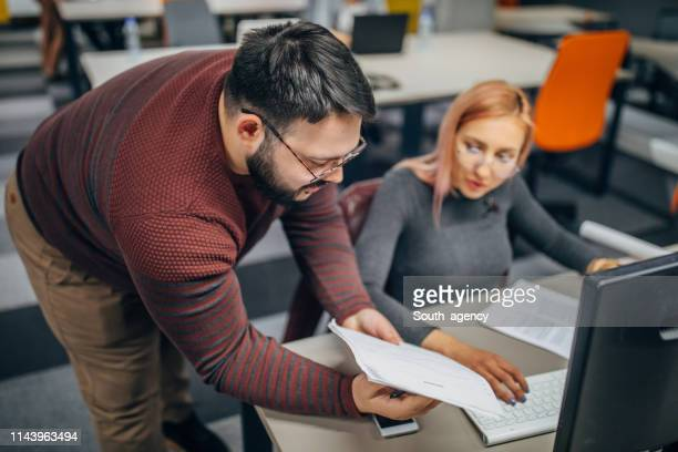 young people working in modern office - fat woman sitting on man stock pictures, royalty-free photos & images