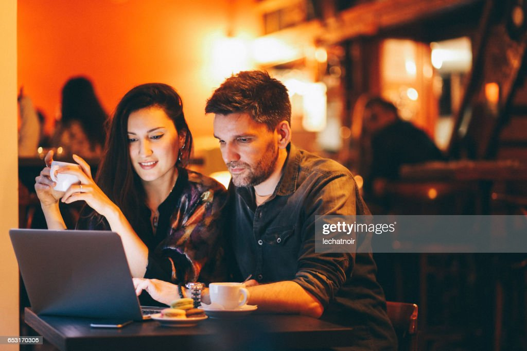 Young people working late in the Belgrade cafe : Foto stock