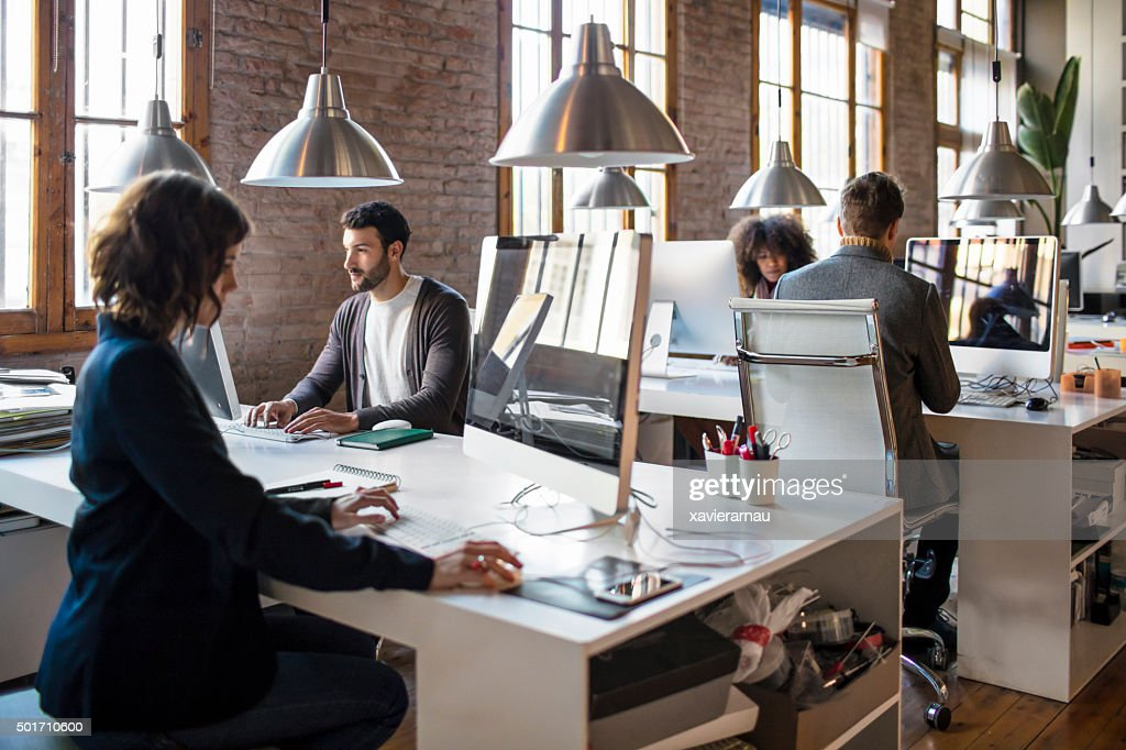 Young people working on a startup office : Stock Photo