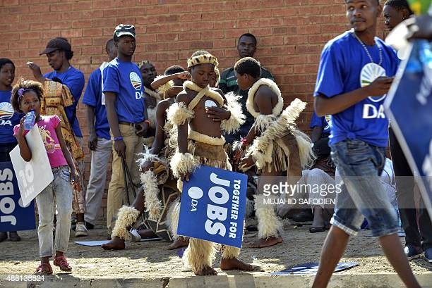 Young performers in Zulu outfit stand with supporters of South Africa's main oppostion party Democratic Alliance gathering at the Walter Sisulu...