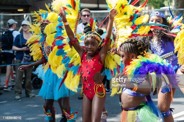 Young performers present their costumes and dance skills during Children's Parade along the streets of West London on the Family Day of the Notting...