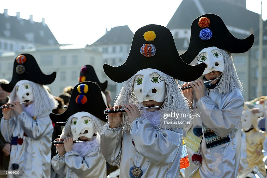 Young performers take part at the 'cotage' of the Basel Fasnacht Carnival on February 18, 2013 in Basel, Switzerland. More than 12,000 participants will take part in the largest carnival in Switzerland that lasts for 72 hours and will be watched by more than 100,000 spectators as it makes its way through the city center.