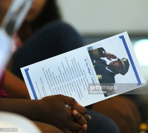 A young person holds a program while waiting for the start of the ceremony where William G Gross was to be sworn in by Mayor Martin J Walsh as...