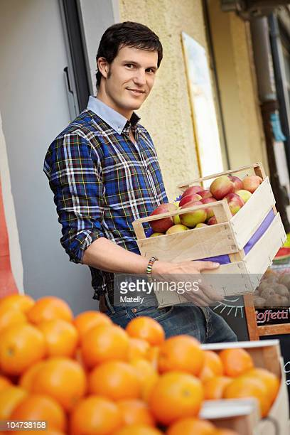 Young person in a fruit stall