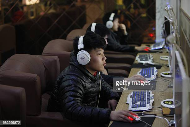 Young person is surfing Internet at a Internet bar in Huaibei Anhui China on 22th March 2015 More than 680 million Chinese people will be online in...