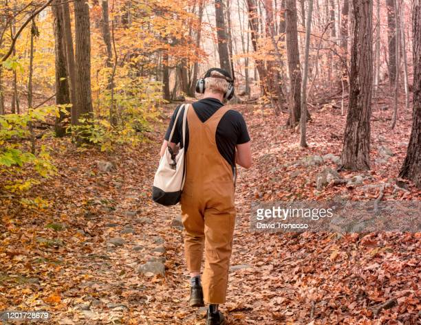 young person walking on the woods - gender fluid stock pictures, royalty-free photos & images