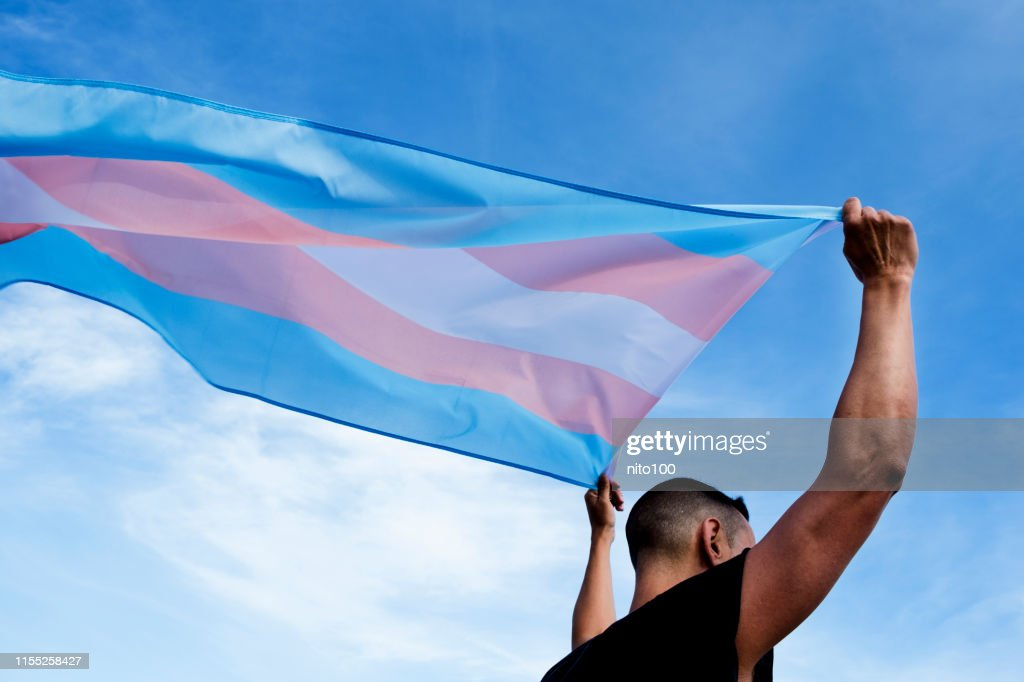 young person with a transgender pride flag : Stock Photo