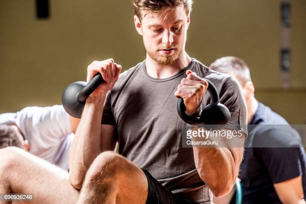 Young Personal Trainer Exercising After Work In A Gym