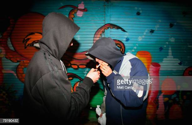 Young persons in hooded tops share a cigarette outside a shop on the Southmead housing estate February 1 Bristol England Bristol City Council is one...