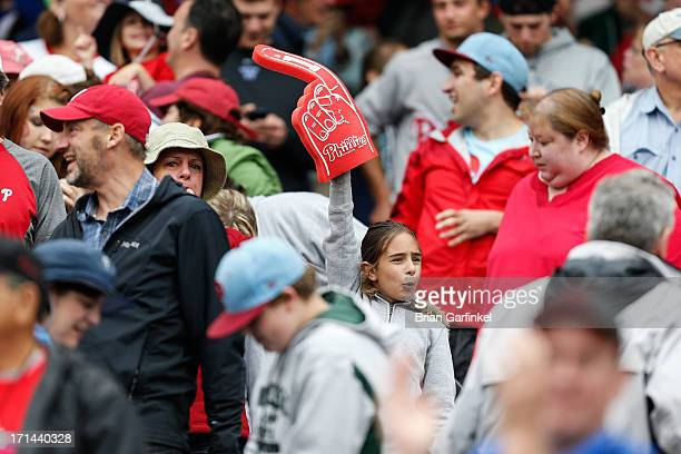 A young Philadelphia Phillies fan holds a foam finger after the game against the Cincinnati Reds at Citizens Bank Park on May 19 2013 in Philadelphia...