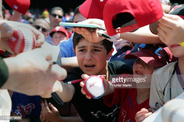 Young Philadelphia Phillies fans ask for an autograph before a game against the Colorado Rockies at Citizens Bank Park on May 19, 2019 in...