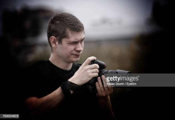 Young Photographer Holding Dslr Camera