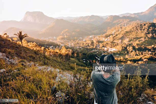 young photographer outdoors - photographer stock pictures, royalty-free photos & images