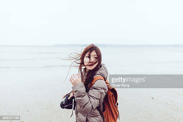 young photographer walking on a beach - seascape stock pictures, royalty-free photos & images