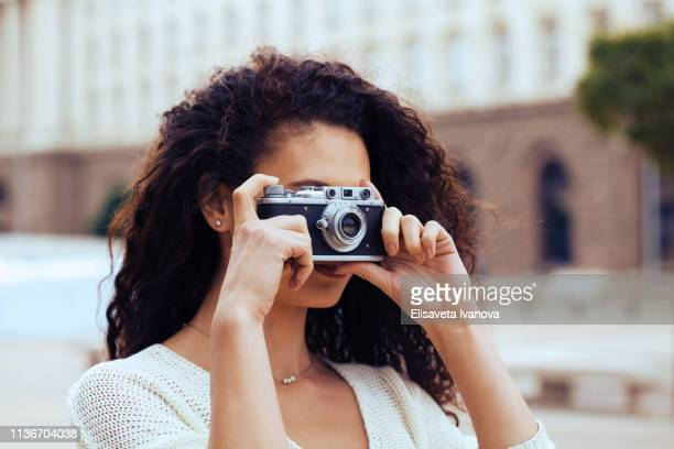 Young photographer with a vintage camera