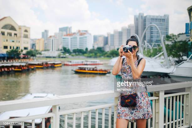 young photographer woman taking images in Singapore
